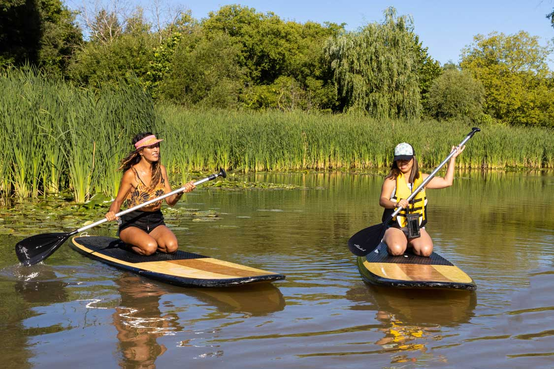 Christina paddling with Indigenous paddleboard operator Oceah Oceah in Toronto