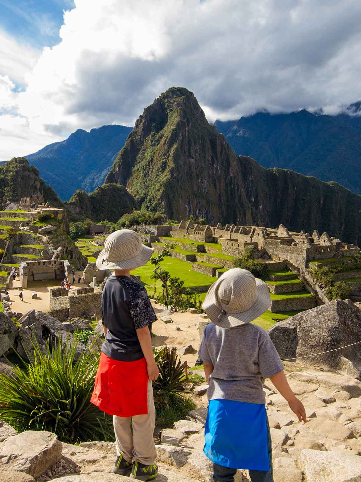 Two children looking out over the ruins of Machu Picchu