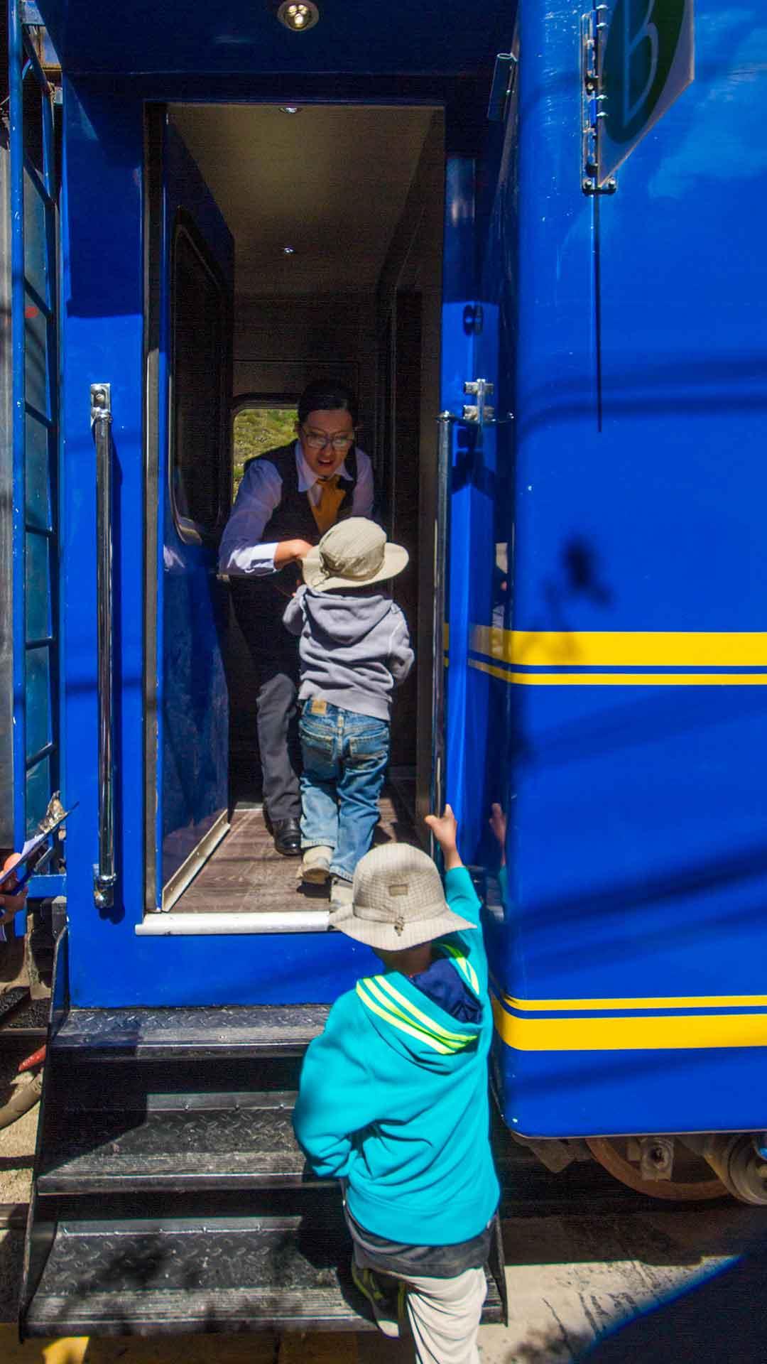 Children boarding the train to Machu Picchu