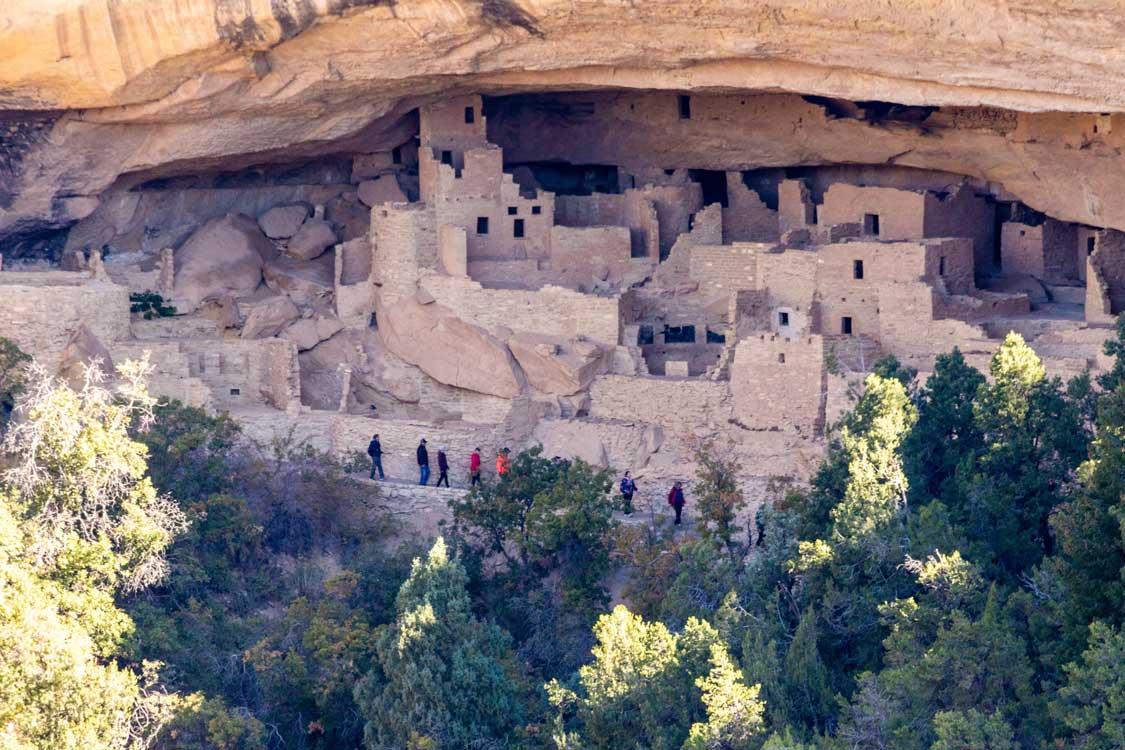 Visitors tour Puebloan ruins in Mesa Verde National Park