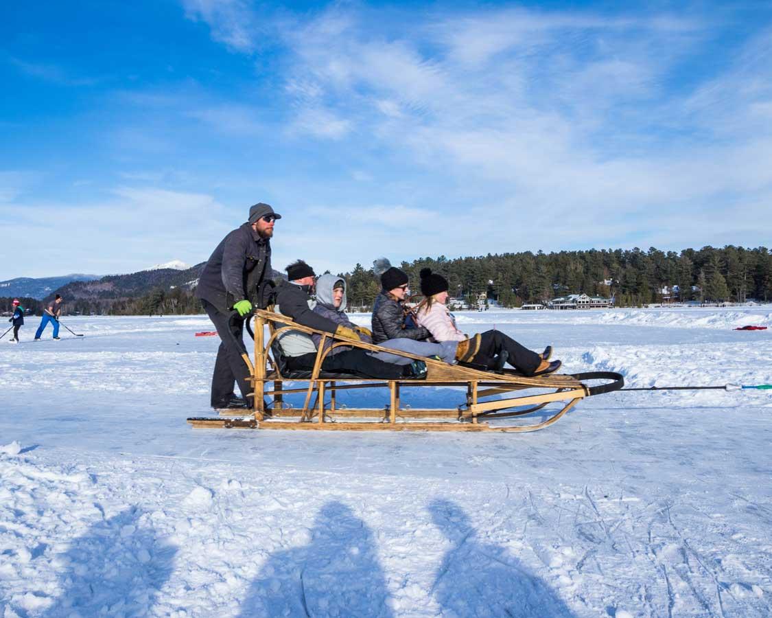 Mirror lake dogsledding in Lake Placid during winter