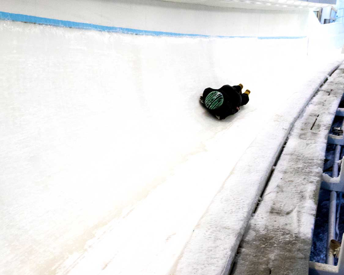 A skeleton athlete practices at the Lake Placid boblsed center
