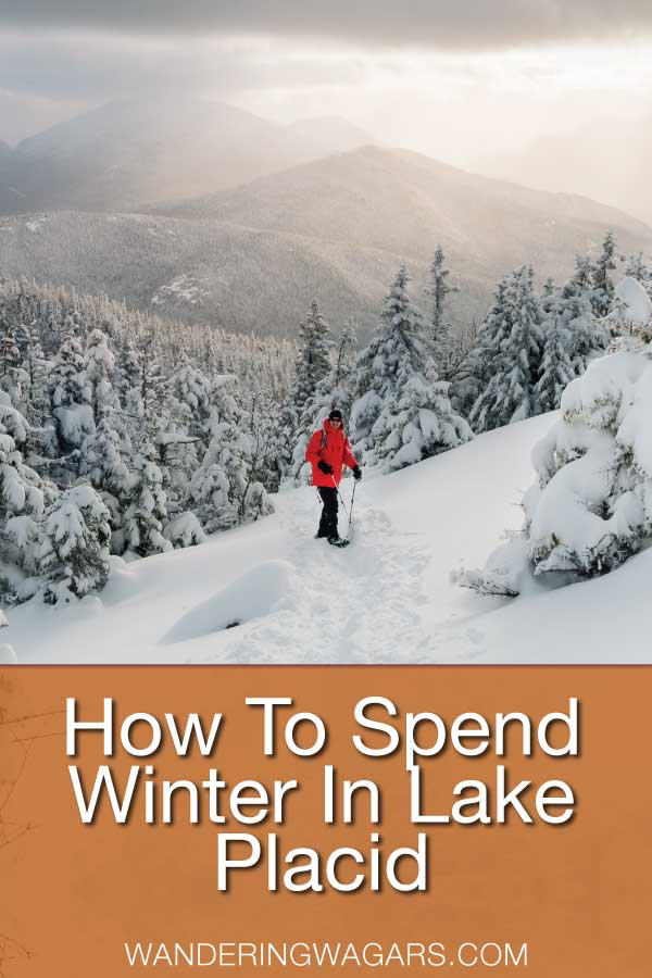 Woman in a red jacket snowshoeing among tree's in the Adirondack Mountains