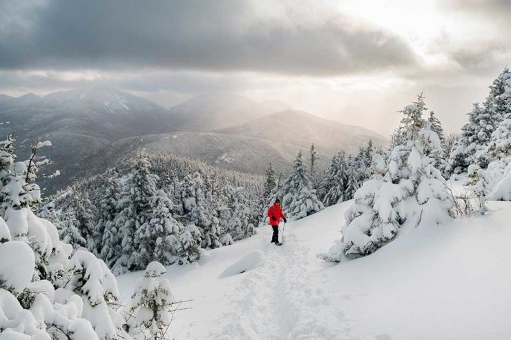 Snowshoer high in the Adirondack Mountains near Lake Placid in winter