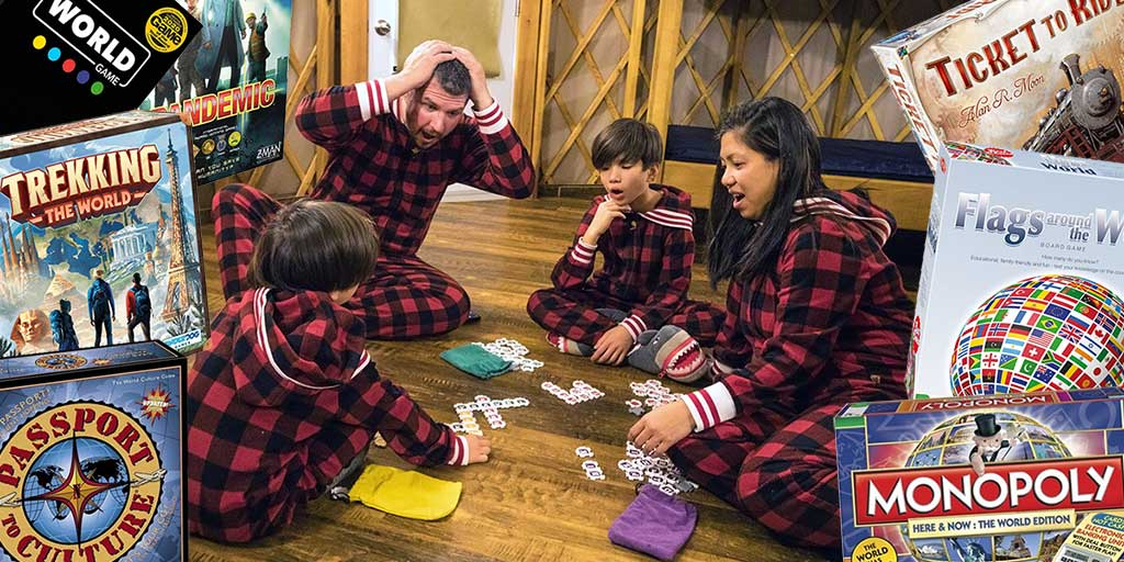 family playing travel-themed board games in a cabin