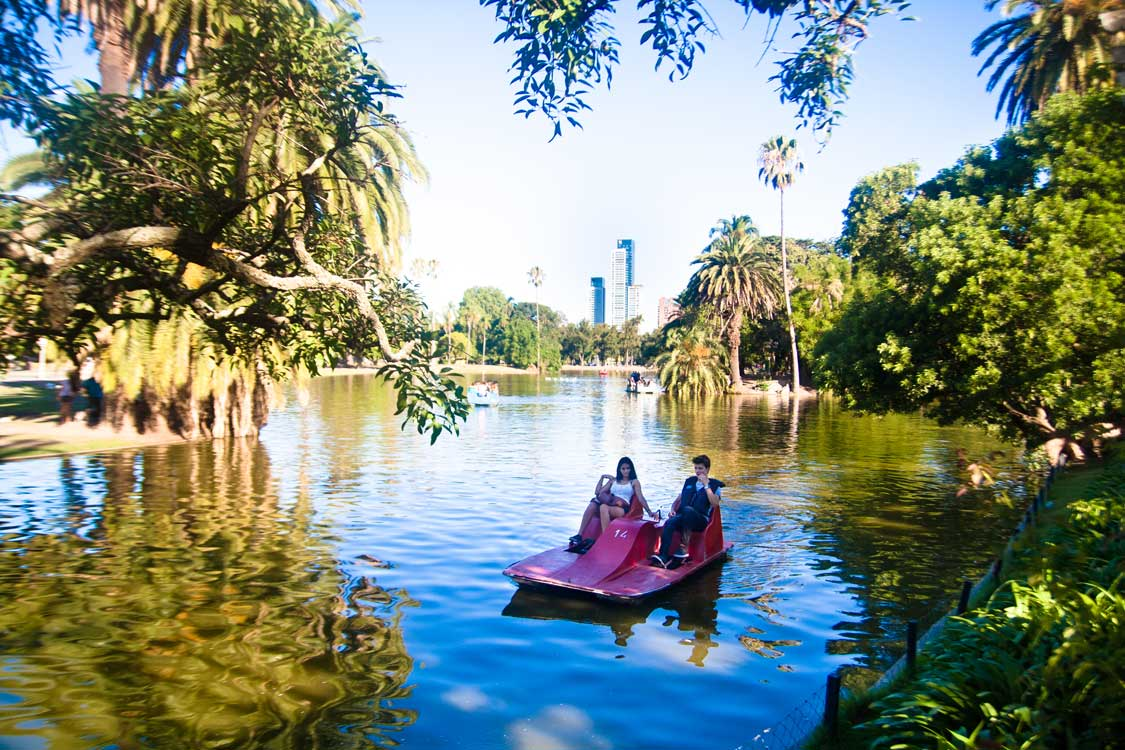 A young couple rides a paddle boat in a Palermo Buenos Aires park
