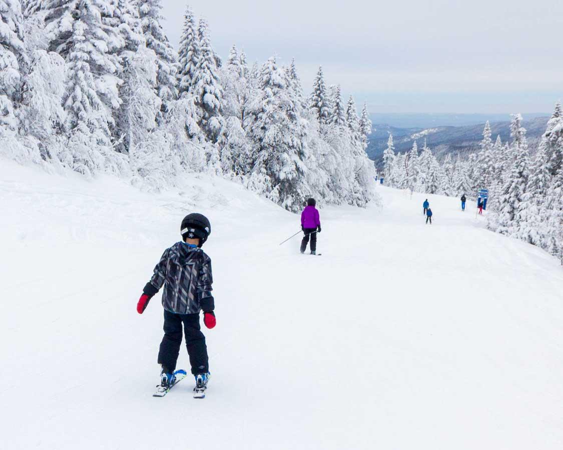 Boy skiing fresh powder in the Catskills of Upstate New York
