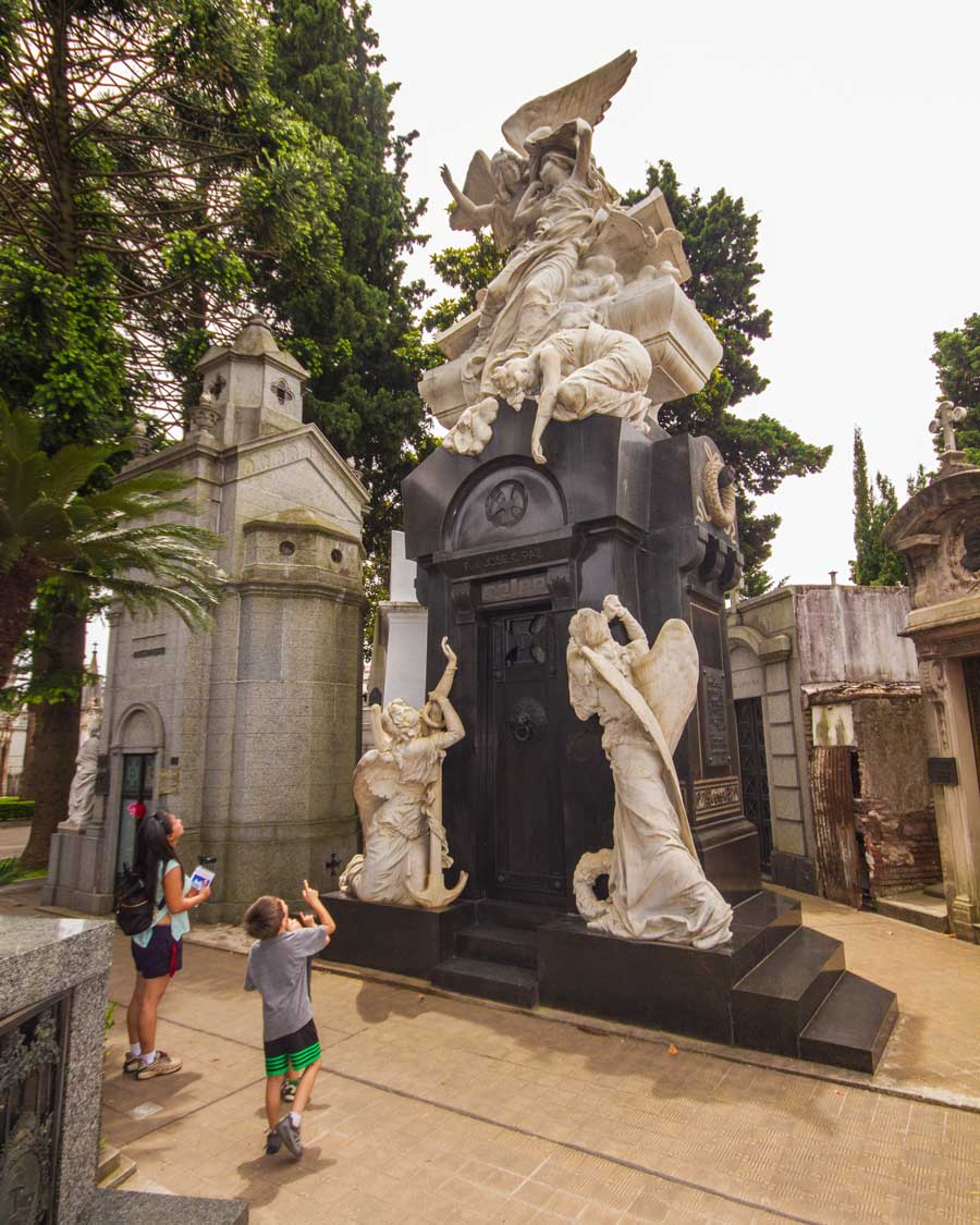 A mother and son wander around Recoleta Cemetery in Buenos Aires for children