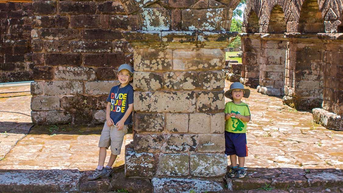 Two boys explore Jesuit ruins in Paraguay