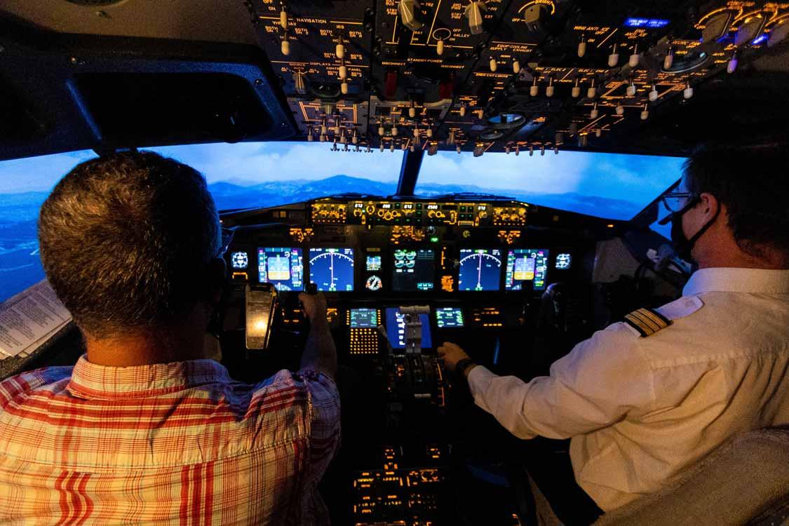 Pilots fly a flight simulator at Aerosim Laval