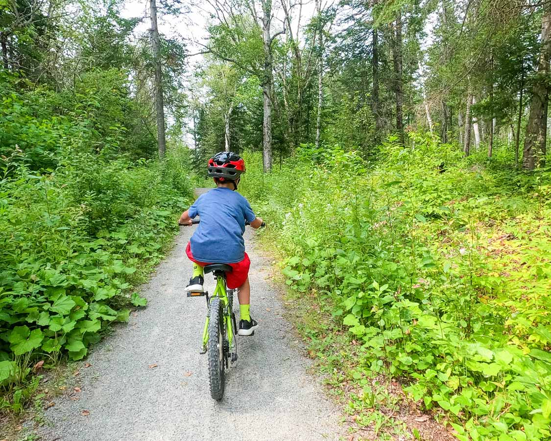 Child cycling in Lac Temiscouata National Park