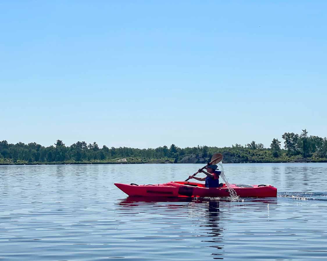 young boy kayaking at Windy Lake Provincial Park