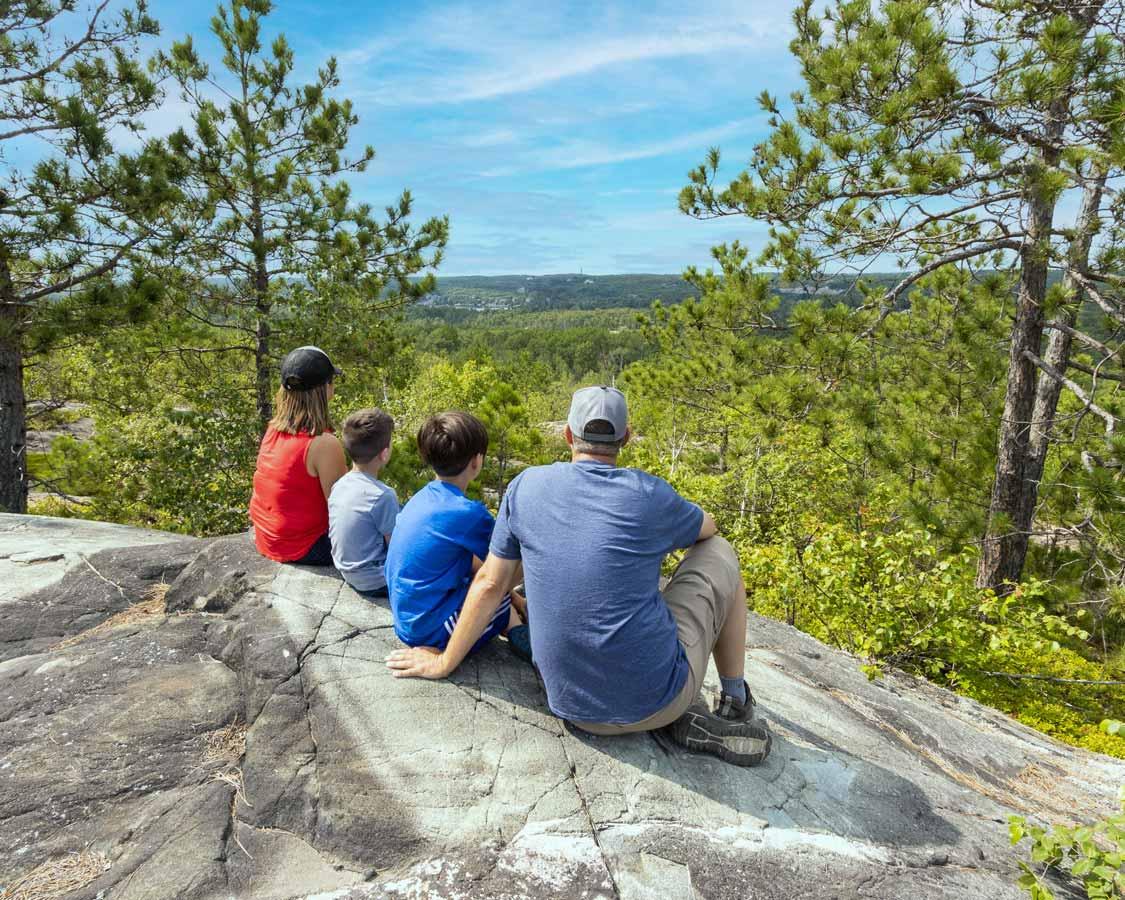 family hiking in Sudbury's Kivi Park