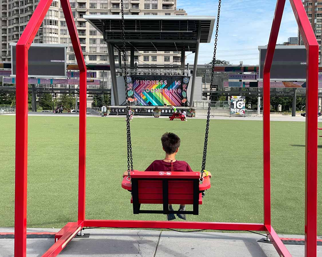 Boy on a swing at Celebration Square Mississauga