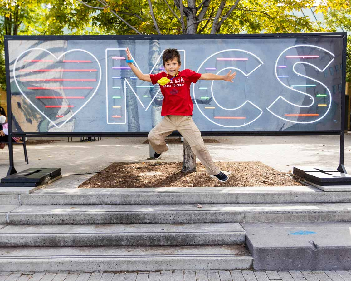 Boy jumping at Celebration Square in Mississauga
