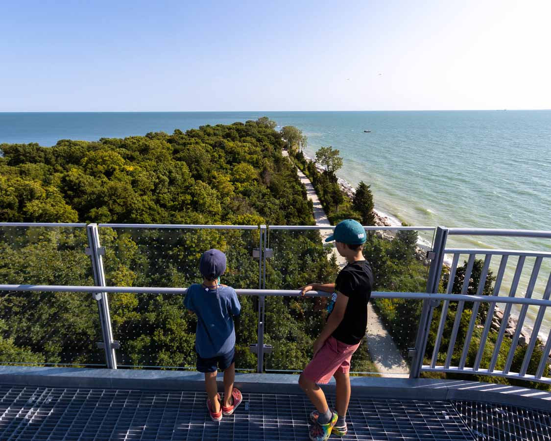 Boys looking out at Point Pelee from the observation tower
